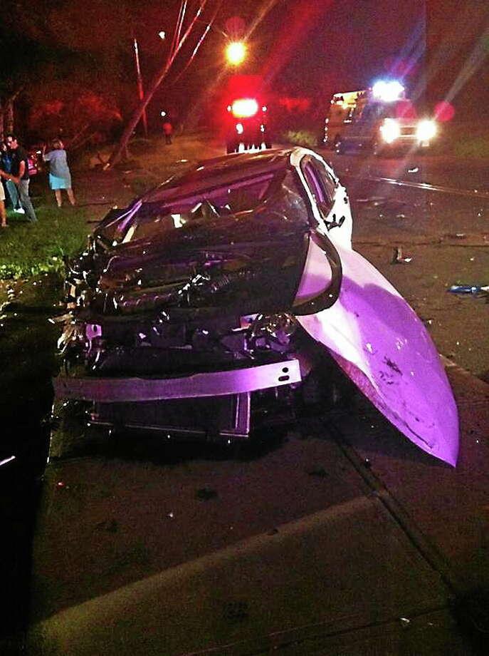 An Acura TSX crashed into an electric pole on Ridge Road near Davis Street in Hamden late Tuesday night. Photo: (Keldy Ortiz — New Haven Register)