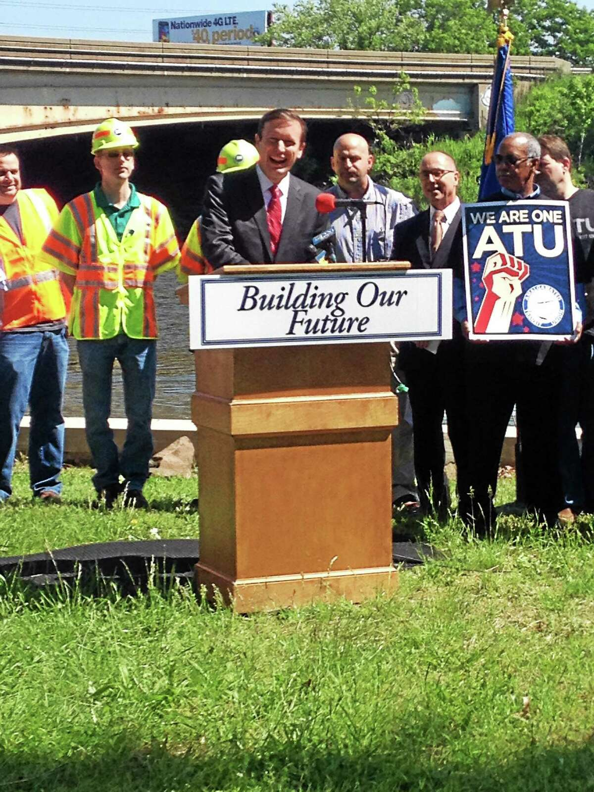 U.S. Sen. Chris Murphy, D-Conn., speaks at a news conference Friday in New Haven about his call for the gas tax to be raised in order to fund infrastructure projects, including bridge replacement and repair.
