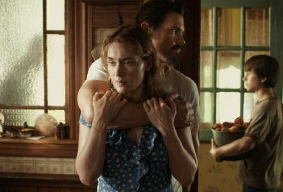 """his image released by Paramount Pictures shows Kate Winslet as Adele, Josh Brolin as Frank and Gattlin Griffith as Henry in """"Labor Day."""""""