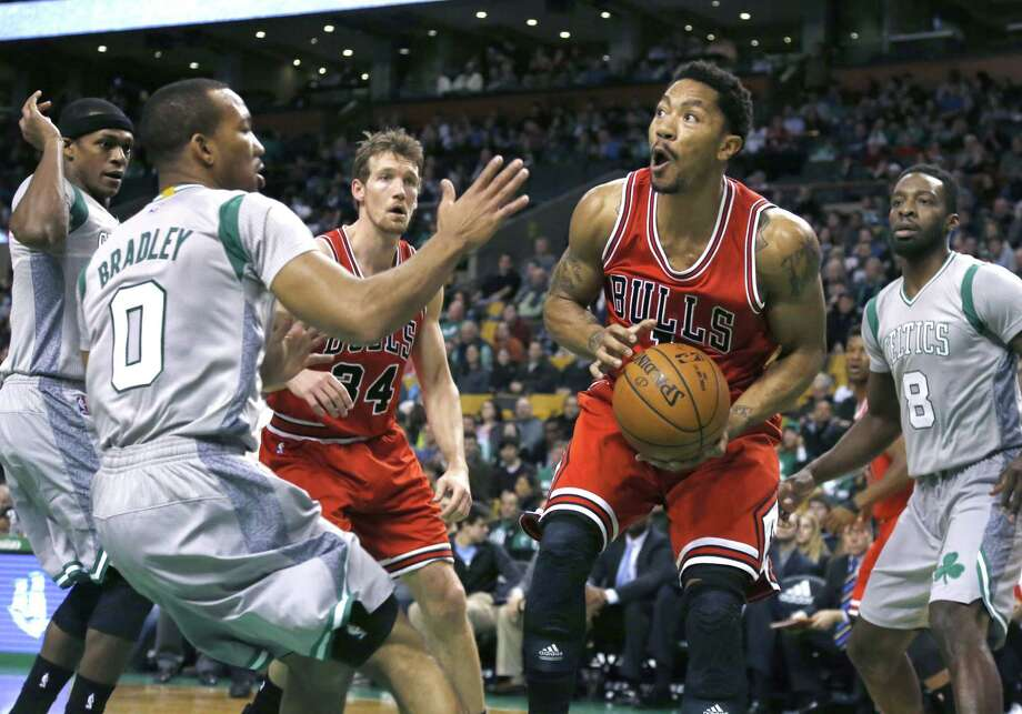Chicago Bulls guard Derrick Rose makes a move with the ball against Celtics guard Avery Bradley (0) during the first half of Friday's game in Boston. Photo: Elise Amendola — The Associated Press   / AP
