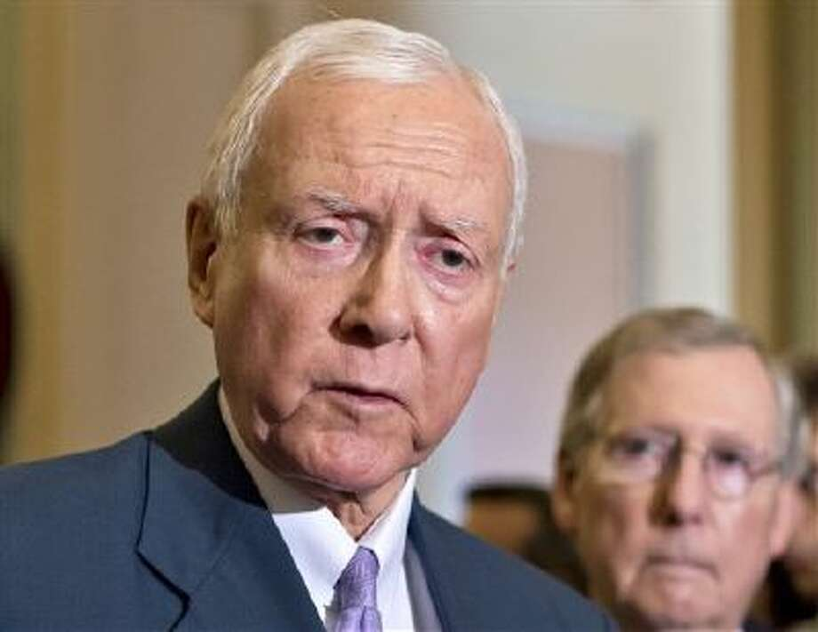 In this July 30, 2013 file photo, Sen. Orrin Hatch, R-Utah, left, accompanied by Senate Minority Leader Mitch McConnell of Ky. speaks with reporters on Capitol Hill in Washington. On Monday, Hatch, Sen. Tom Coburn, R-Okla. and Sen. Richard Burr, R-N.C. proposed repealing the nation's controversial health care law in favor of a Republican replacement. (AP) Photo: AP / AP