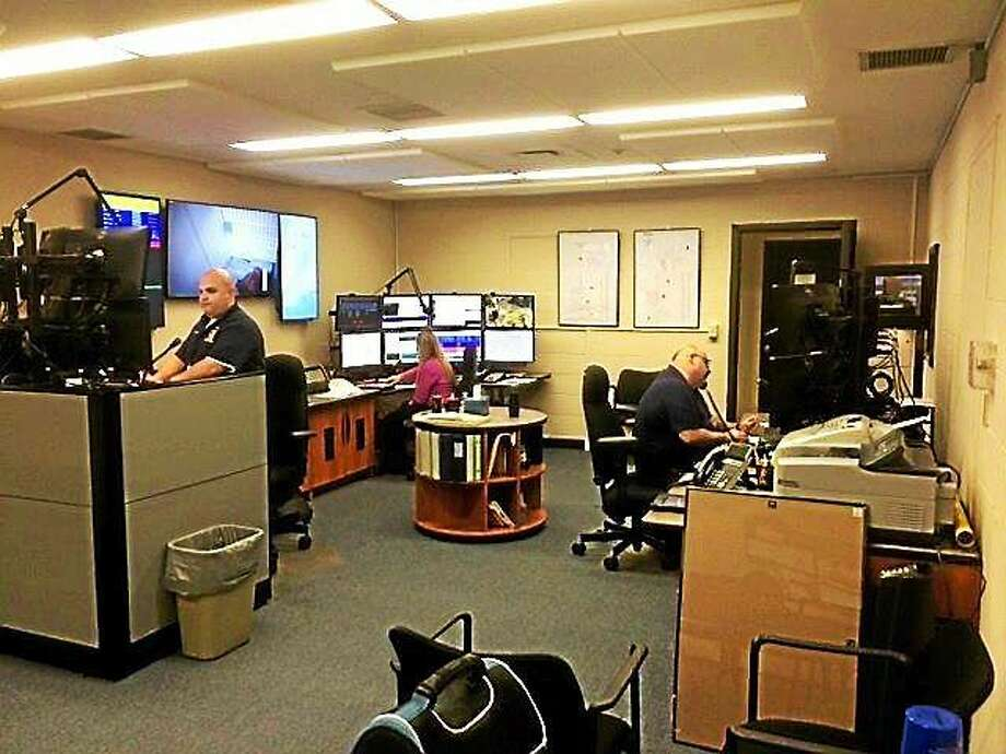 Dispatchers Stephen Johnson, Caitlin Mulherin and Lead Dispatcher Ralph Vuolo Jr. pictured in their new office located in the police department. Photo: Contributed Photo