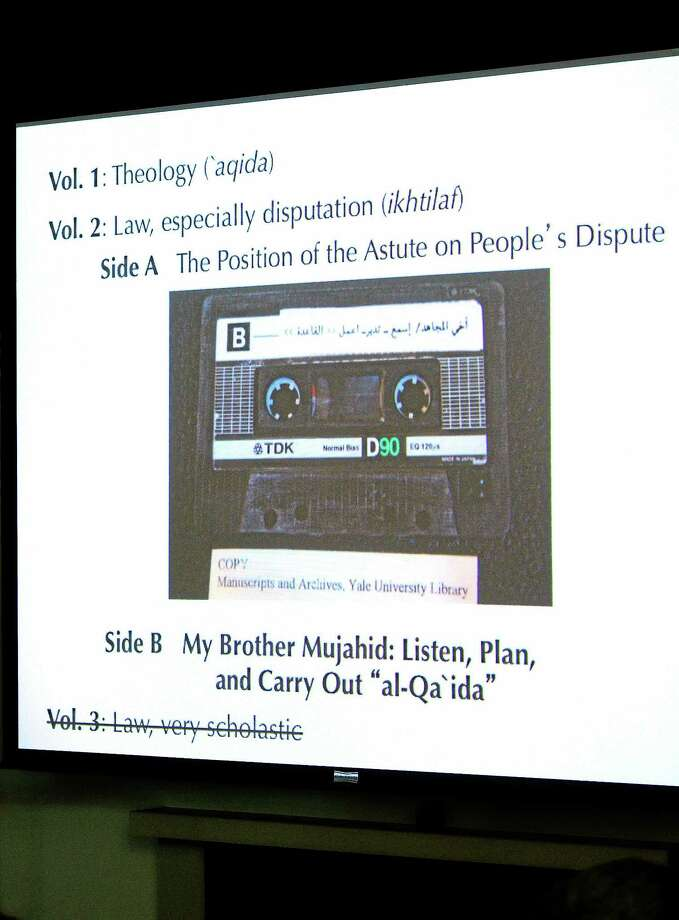 One of the images used during  Miller's presentation is a photograph of one of the audiotapes from Osama Bin Laden's former home in Kandahar, Afghanistan. Photo: (Arnold Gold-New Haven Register)