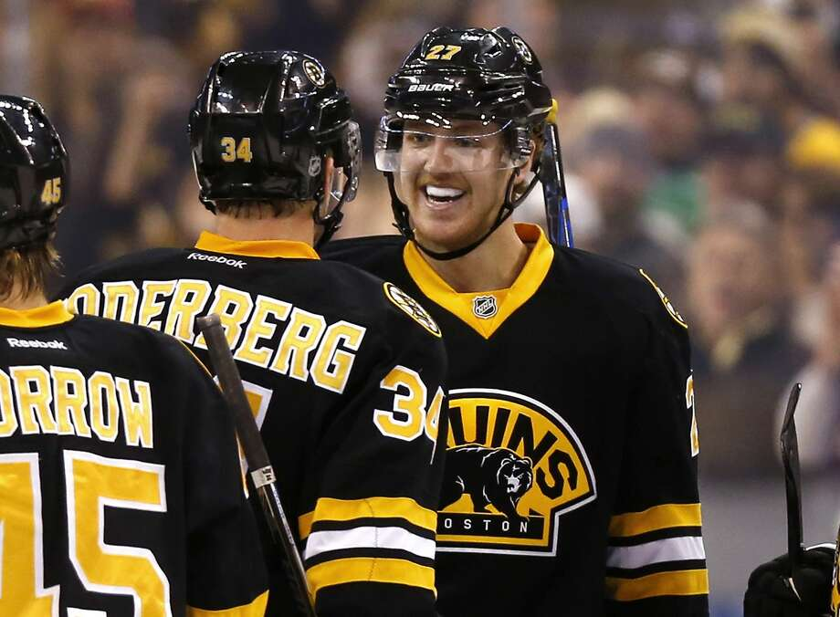 Defenseman Dougie Hamilton, right, is congratulated by Carl Soderberg after Hamilton's overtime goal gave the Bruins a 2-1 win over the Winnipeg Jets on Friday in Boston. Photo: Winslow Townson — The Associated Press   / FR170221 AP
