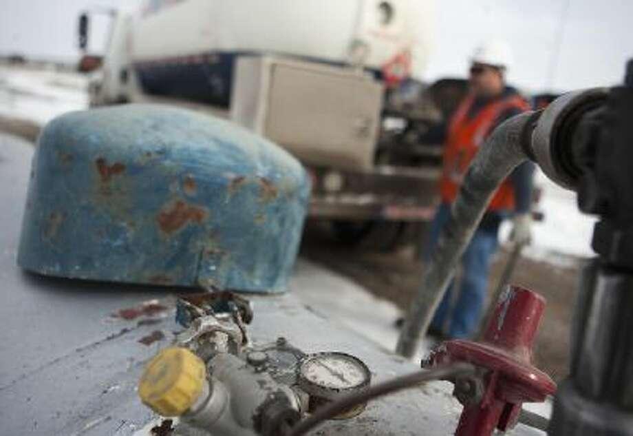 AmeriGas employee Jay Carlson fills a tank with propane near Galesburg