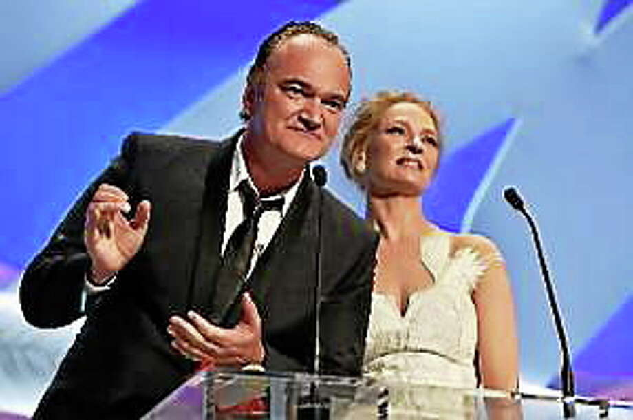 Quentin Tarantino and Uma Thurman appear on stage to give the Palme d'Or award during the Closing Ceremony at the 67th Annual Cannes Film Festival on May 24, 2014, in Cannes, France. Photo: (Pascal Le Segretain — Getty Images)