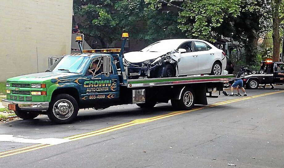 Three adults and one infant were sent to the hospital after a four-car crash Wednesday in New Haven. Photo: Kristin Stoller — New Haven Register