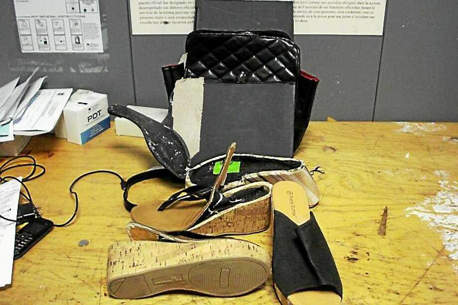 U.S. Customs and Border Protection Officers say they seized cocaine in Janisha Amalee Atkins' shoes and pocketbook. Photo: Photo Courtesy Of U.S. Customs And Border Protection