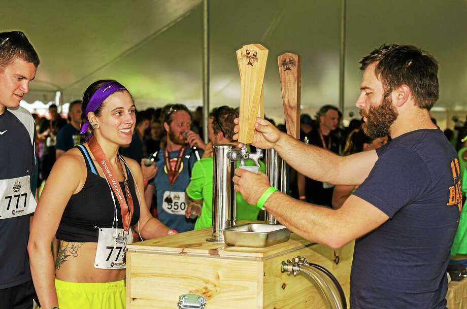 Runners line up for a taste Banded Horn Brewing from Maine after a previous run. Photo: Contributed Photo