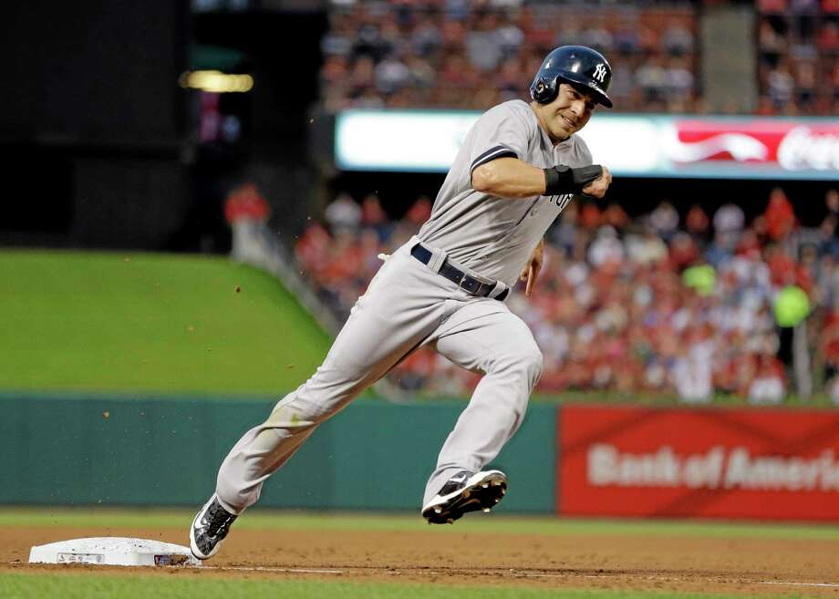 New York Yankees' Jacoby Ellsbury rounds third and heads for home on a two-run single by John Ryan Murphy during the third inning against the St. Louis Cardinals Wednesday. Photo: Jeff Roberson  — The Associated Press   / AP