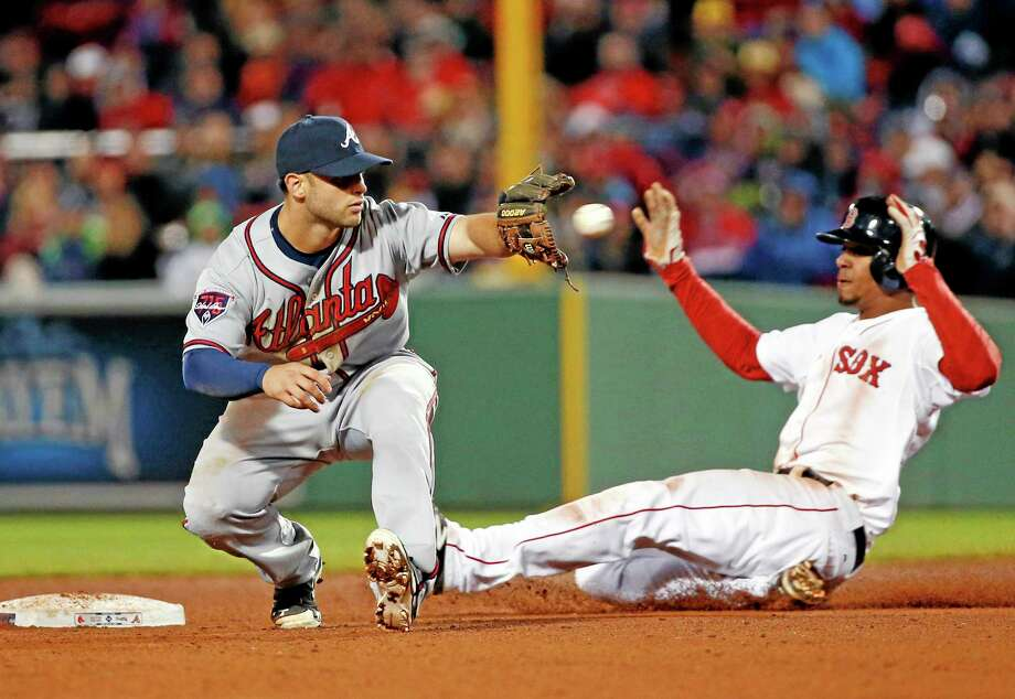 Atlanta Braves second baseman Tommy La Stella takes a late throw after a wild pitch by relief pitcher Anthony Varvaro, as Boston Red Sox's Xander Bogaerts, right, slides in safely to take second in the eighth inning Wednesday. Photo: Elise Amendola  — The Associared Press   / AP