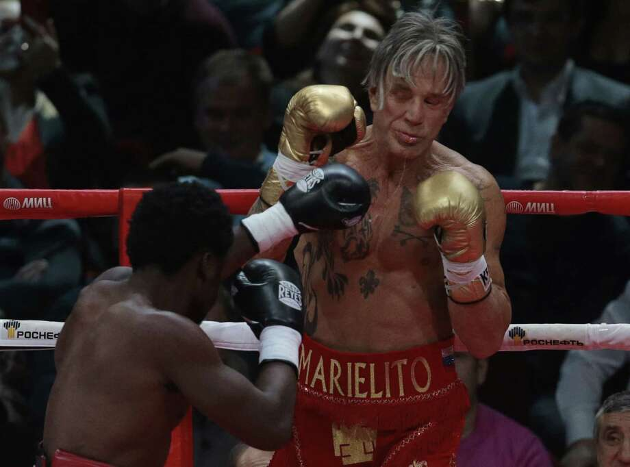 Actor Mickey Rourke, right, holds up his guard against his opponent Elliot Seymour of the United States during their professional boxing match Friday at the Luzhniki Stadium in Moscow. Photo: Associated Press   / AP