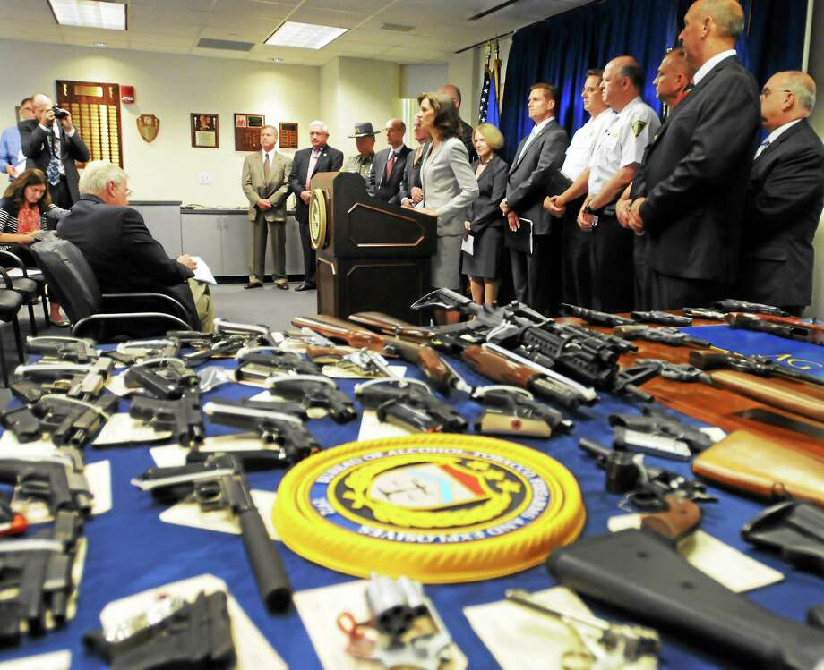 In this June 25 photo, U.S. Attorney Deirdre Daly and other law enforcement officials announced a Bureau of Alcohol, Tobacco, Firearms and Explosives-led investigation that resulted in the seizure of more than 73 illegal firearms in Connecticut and was expected to result in the prosecution of 154 individuals on federal or state charges. Photo: Peter Hvizdak — New Haven Register   / ©Peter Hvizdak /  New Haven Register