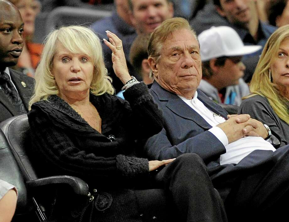 In this Nov. 12, 2010 file photo, Clippers owner Donald Sterling, right, sits with his wife, Shelly, during a game against the Detroit Pistons in Los Angeles. Photo: Mark J. Terrill — The Associated Press File Photo   / AP