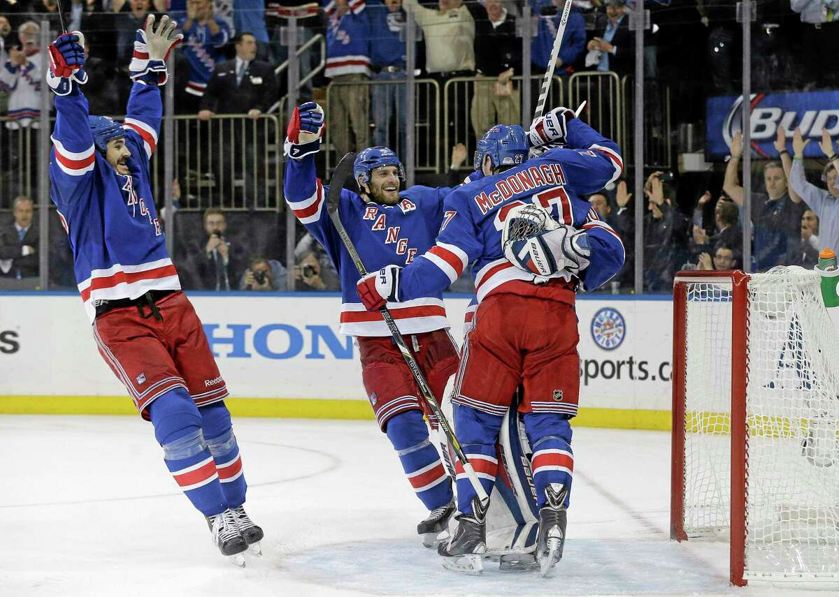 The Rangers celebrate after beating the Montreal Canadiens 1-0 in Game 6 of the Eastern Conference finals on Thursday in New York. The Rangers advance to the Stanley Cup finals.
