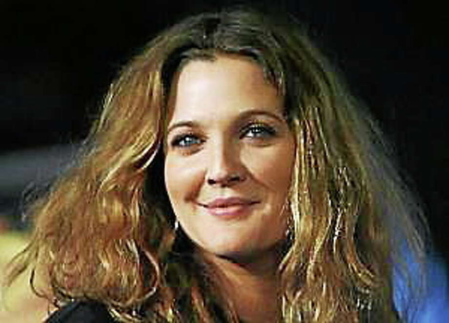 "Drew Barrymore arrives at the Los Angeles premiere of ""We Are Marshall"" on Dec. 14, 2006. Photo: (Matt Sayles — The Associated Press)"