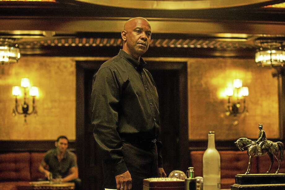 "(AP Photo/Sony, Columbia Pictures, Scott Garfield)  Denzel Washington appears in a scene from the film, ""The Equalizer."" Photo: AP / Columbia Pictures, Sony"