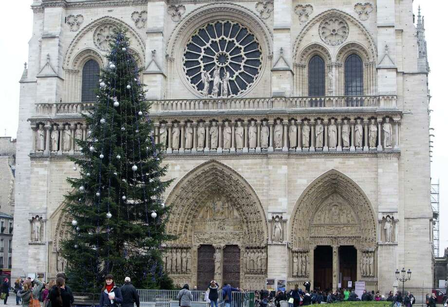 The Christmas tree in front of Notre Dame cathedral in Paris Tuesday. Notre Dame Cathedral in Paris has a Christmas tree this year thanks to an unusual patron: the Russian government. Amid high tensions between Russia and the West over violence in Ukraine, Russiaís ambassador to France says the ìtree is a message of peace. Photo: Associated Press   / AP
