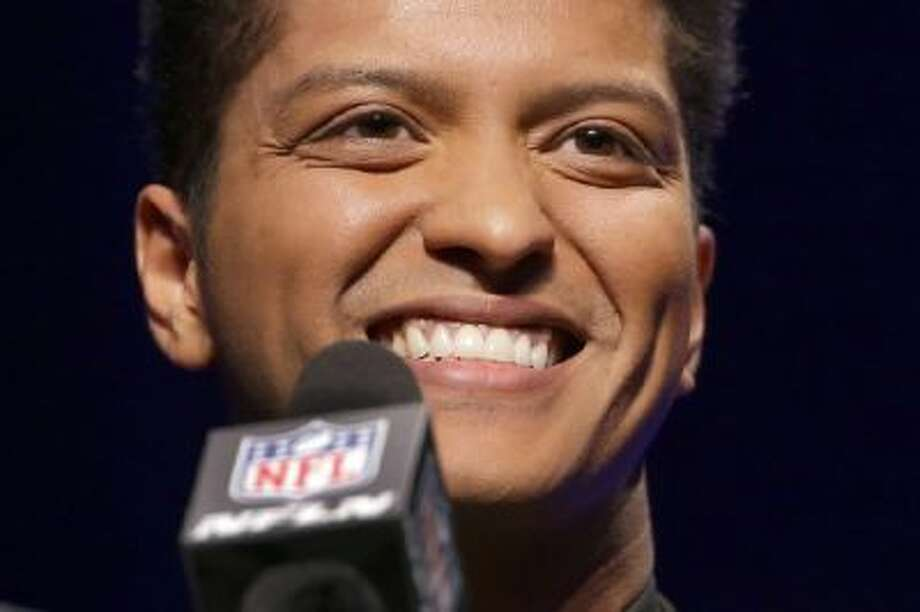 Bruno Mars who will headline the half-time show at the NFL Super Bowl XLVIII football game speaks during a press conference Thursday, Jan. 30, 2014, in New York.