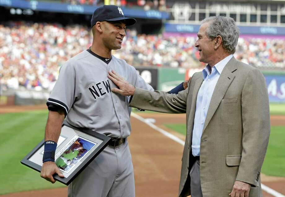 New York Yankees Derek Jeter, left, and former President George W. Bush greet each other during a ceremony honoring Jeter before a Wednesday's game against the Texas Rangers in Arlington, Texas. Photo: LM Otero — The Associated Press   / AP