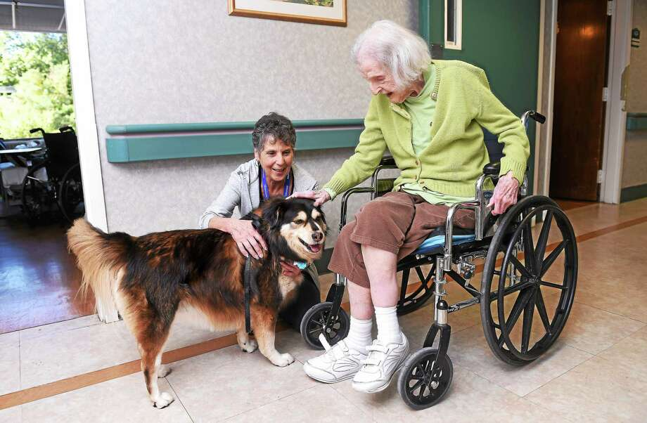 (Arnold Gold-New Haven Register)  Teri Misbach (center) of Wallingford with her dog, Dakota, visits with Mary Kessler at the Masonicare Health Center in Wallingford last week. Photo: Journal Register Co.