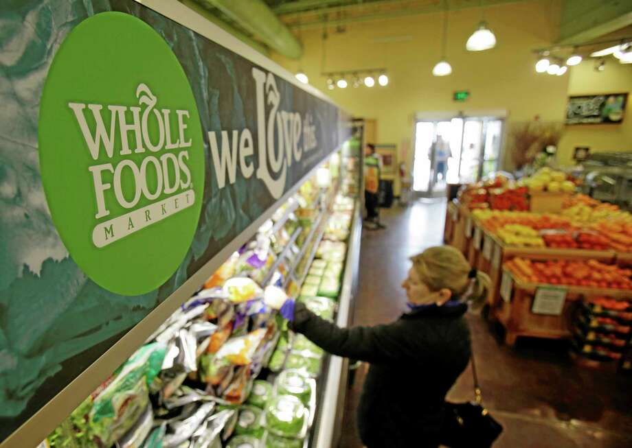 In this March 27 photo, a woman shops at the Whole Foods Market in Woodmere Village, Ohio. Photo: Tony Dejak — The Associated Press   / AP