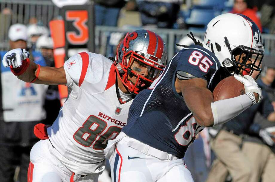 UConn receiver Geremy Davis, right, will be the leader of the Huskies' offense this season. UConn is tied for ninth in the American Athletic Conference preseason poll. Photo: Fred Beckham — The Associated Press File Photo   / FR153656 AP