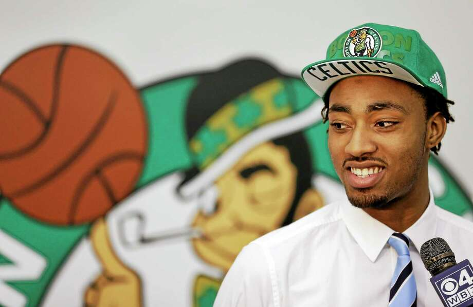 Boston Celtics first-round draft pick James Young stands in front of the team logo while speaking with members of the media on June 30 in Waltham, Mass. Photo: Steven Senne — The Associated Press File Photo   / AP