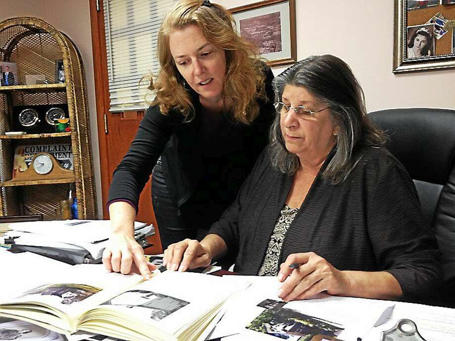 "From Left to Right: Sheila McCreven, a local resident and Town Clerk Stephanie Ciarleglio, pore over information for a reprinted version of ""Historic Woodbridge."" Photo: Pam McLoughlin/New Haven Register"
