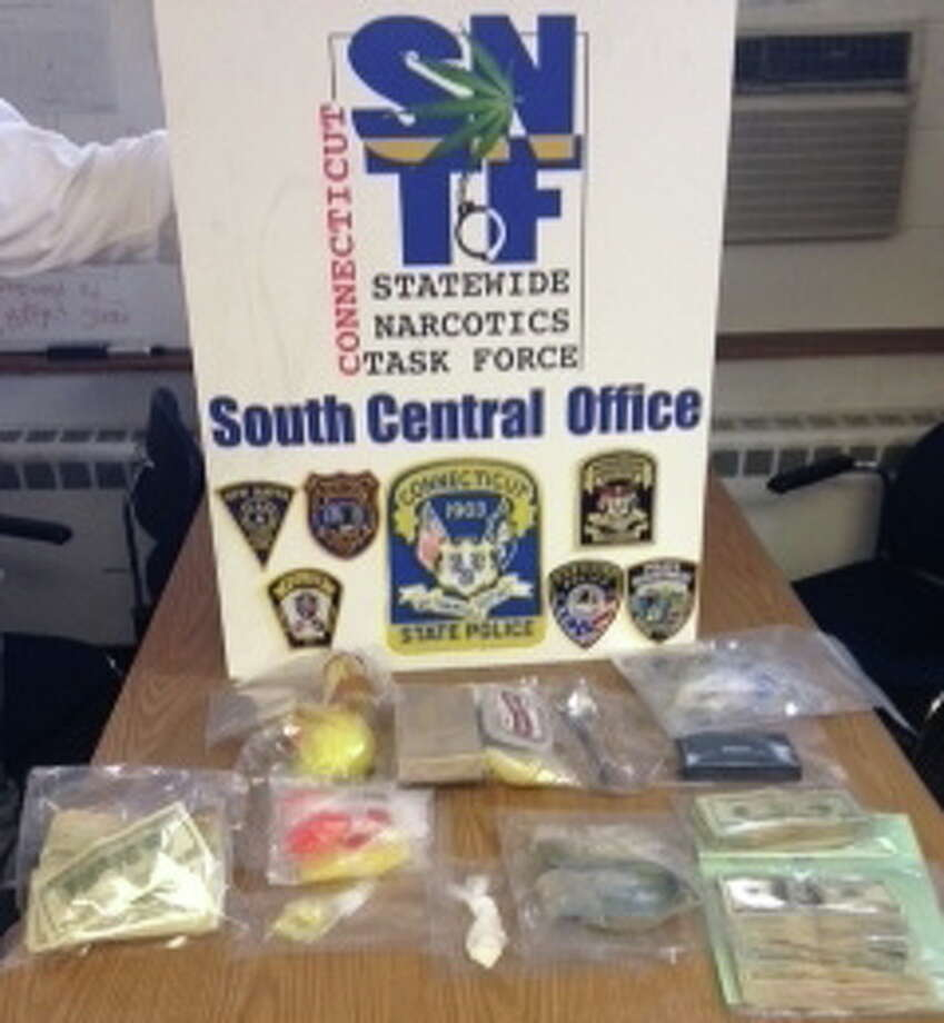 Raids on three locations in West Haven led police to seize marijuana, crack cocaine, heroin and $16,700 in cash, state police said. Two people were charged with drug offenses. Photo: Contributed Photo — State Police