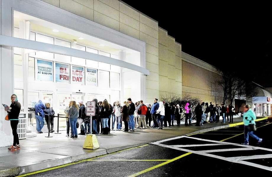 Customers wait for the 6 p.m. opening at the Kohl's store in Wallingford Thursday evening. Photo: Peter Hvizdak — New Haven Register    / ©2014 Peter Hvizdak