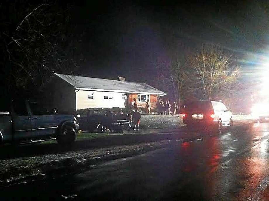 Emergency responders at Wednesday night's fire in Orange. Photo: Helen Bennett/New Haven Register