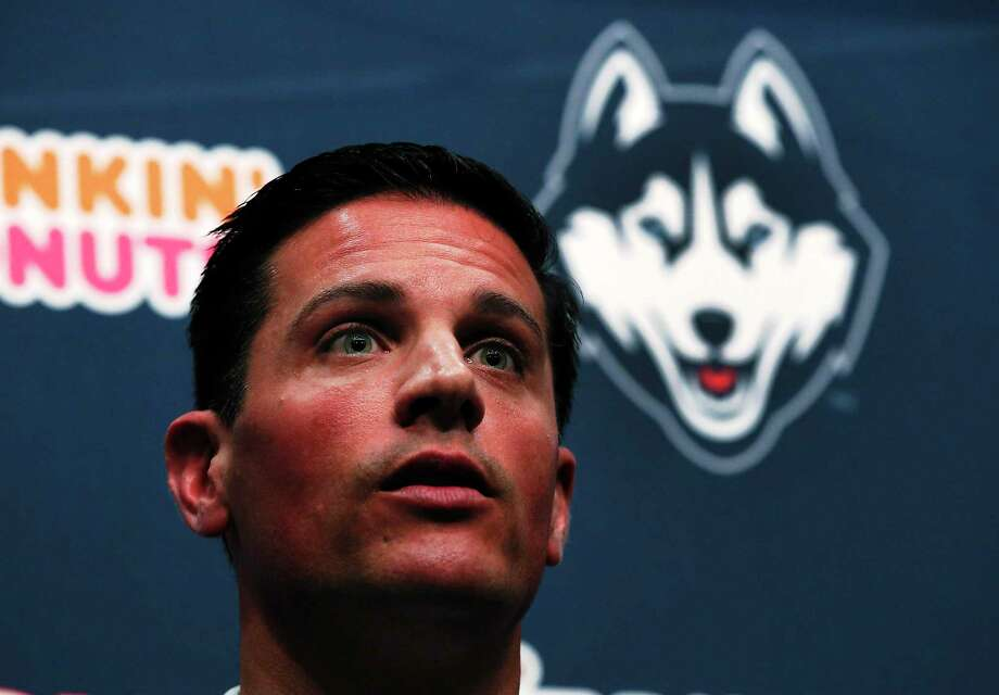 Bob Diaco, former Notre Dame defensive coordinator, speaks as Connecticut's new head football coach during an introductory news conference on campus in Storrs, Conn., Thursday, Dec. 12, 2013. (AP Photo/Elise Amendola) Photo: AP / AP