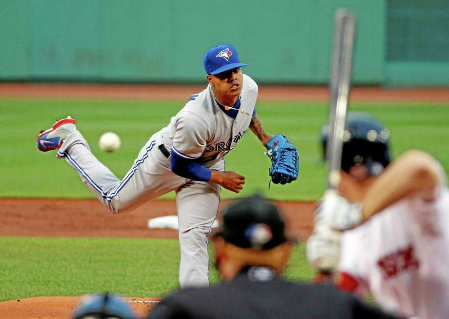 Blue Jays starting pitcher Marcus Stroman delivers to the Boston Red Sox during the first inning of Tuesday. Stroman collected the win in a 4-2 decision. Photo: Elise Amendola  — The Associated Press   / AP
