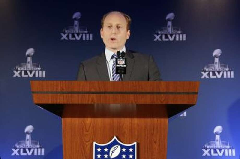 Jeff Miller, with the NFL, speaks during a news conference on health and safety at the NFL Super Bowl XLVIII media center, Thursday in New York.