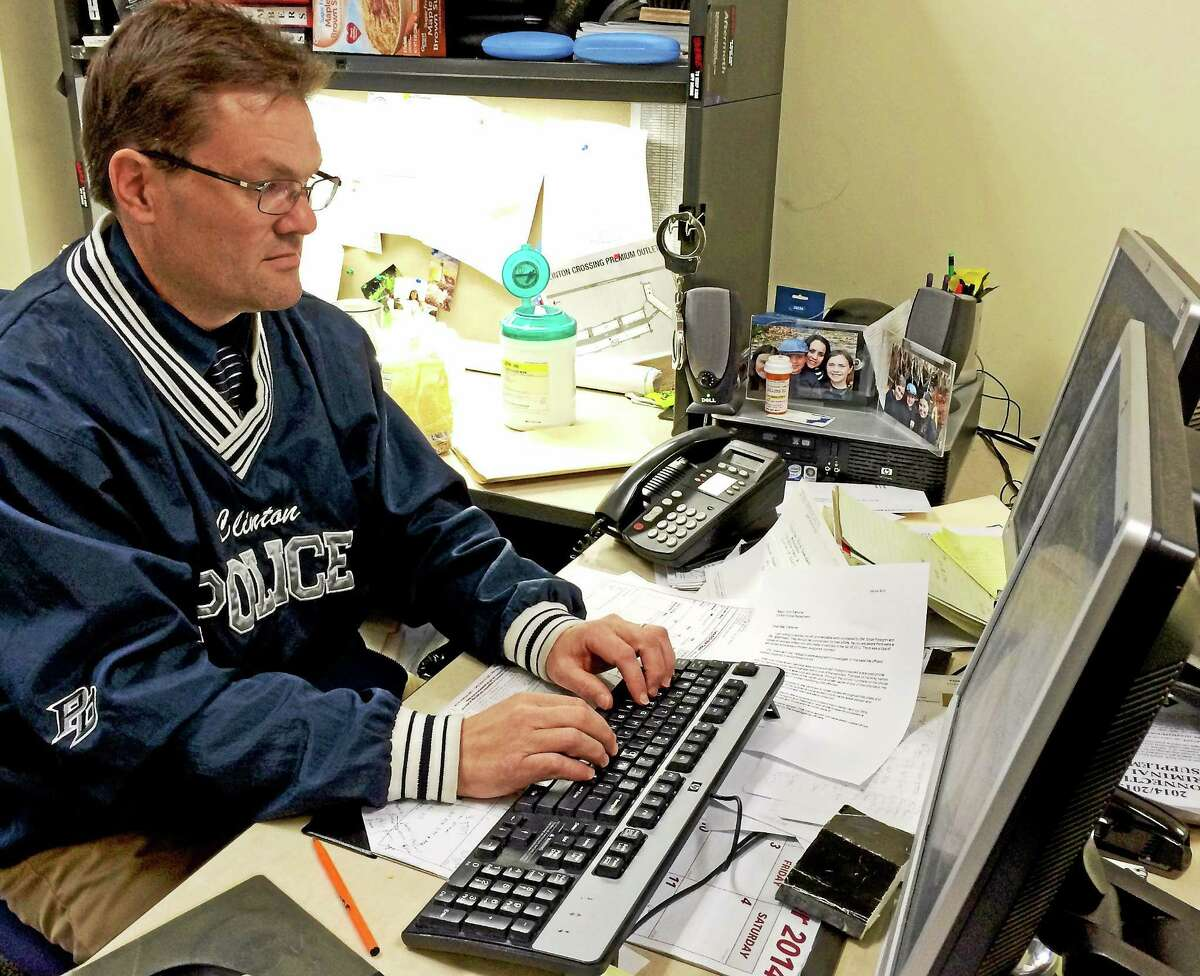 Clinton Detective Bryan Pellegrini checks the internet for any leads on the missing teens.