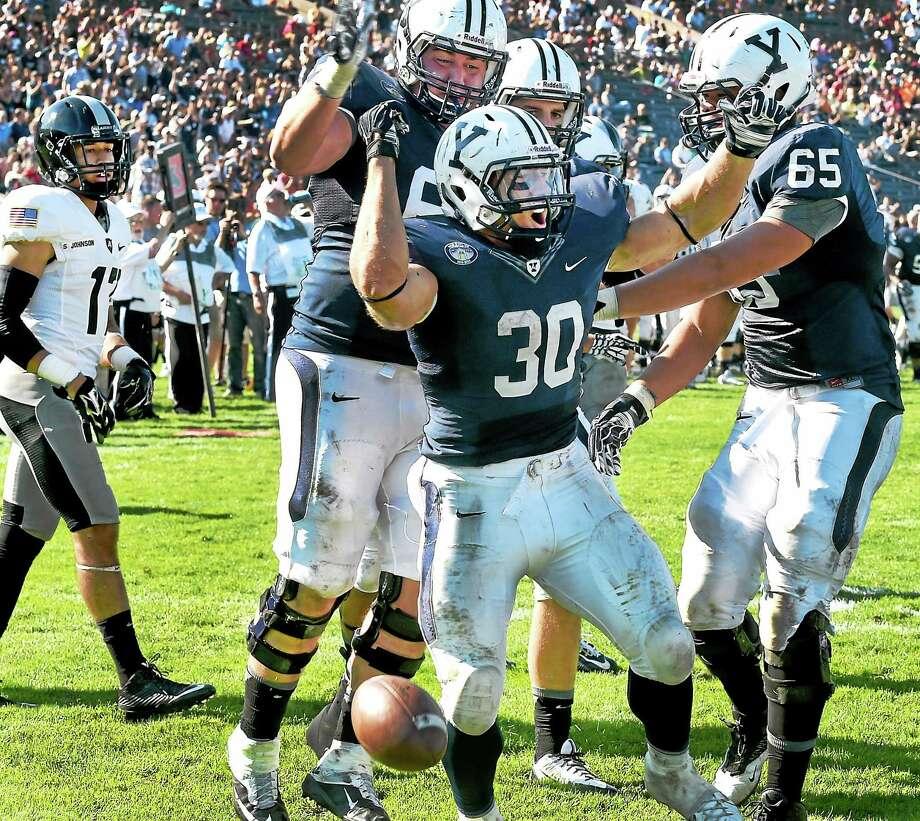 Yale running Back Tyler Varga, center, celebrates a touchdown against Army during third quarter on Saturday. Photo: Peter Hvizdak — Register   / ©2014 Peter Hvizdak