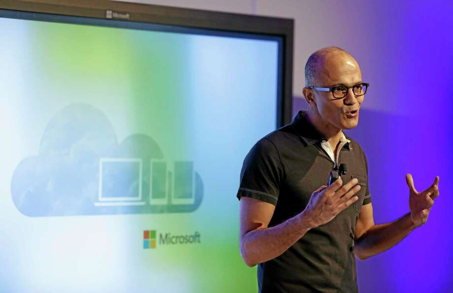 Microsoft CEO Satya Nadella gestures while speaking during a press briefing on the intersection of cloud and mobile computing Thursday, March 27, 2014, in San Francisco. Microsoft unveiled Office for the iPad, a software suite that includes programs such as Word, Excel and PowerPoint, and works on rival Apple Inc.'s hugely popular tablet computer. (AP Photo/Eric Risberg) Photo: AP / AP