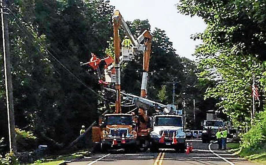 Utility crews work to fix a pole that was damaged in a crash early Tuesday in Madison. The accident closed Route 79 north of Route 80 for several hours. Photo: Contributed Photo — @Madison911 On Twitter