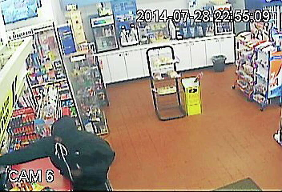 Surveillance photo shows a robbery Monday at the Quick Food Mart, 305 New Haven Ave., Milford. Photo: Contributed Photo — Milford Police