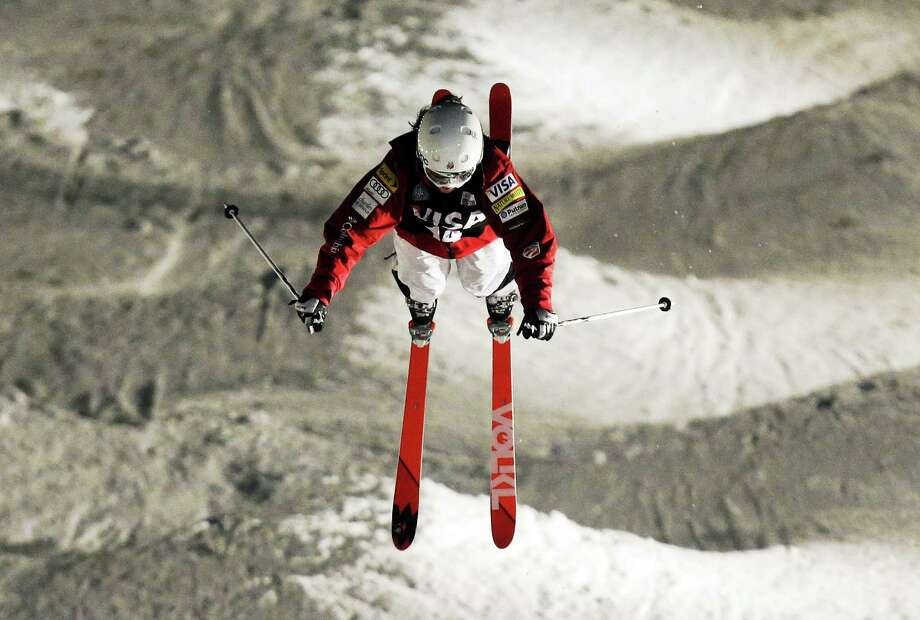 Associated Press / Rick Bowmer  Eliza Outtrim, of Hamden, competes during the women's freestyle World Cup moguls event Saturday, Jan. 11, in Park City, Utah. Outtrim came in fourth place. Photo: AP / AP