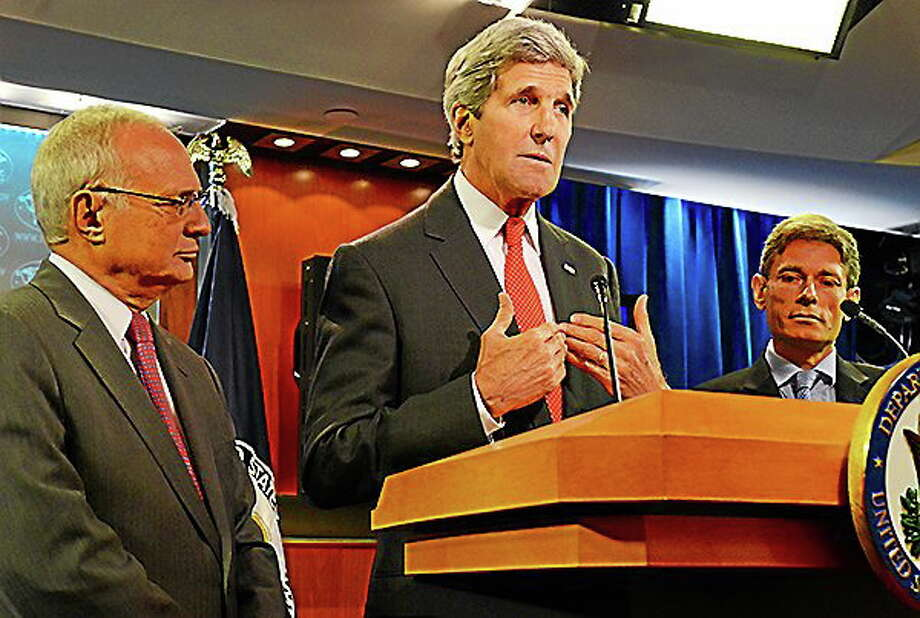 Secretary of State John Kerry released the 2013 annual report on international religious freedom at the U.S. Department of State in Washington, D.C., on July 28, 2014. Flanking Kerry is David Saperstein, left, President Obamaís nominee to serve as ambassador-at-large for international religious freedom, and Tom Malinowski, assistant secretary of state for democracy, human rights and labor. Photo: Photo Courtesy: U.S. Department Of State