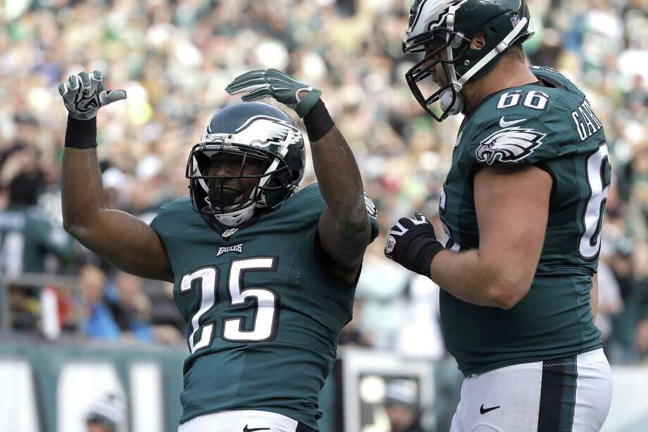 Eagles running back LeSean McCoy, left, celebrates with Andrew Gardner after McCoy's touchdown on Sunday against the Tennessee Titans in Philadelphia. Photo: Michael Perez — The Associated Press   / FR168006 AP