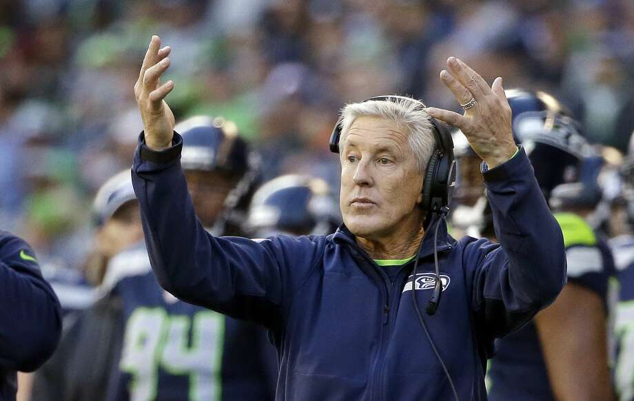 Seahawks head coach Pete Carroll motions to his team during Sunday's game against the Arizona Cardinals in Seattle. Photo: Elaine Thompson — The Associated Press   / AP