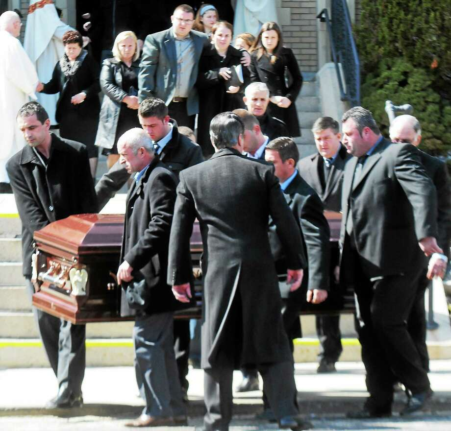 Kristjan Ndoj's family watches his casket being carried by pallbearers after the Mass of Christian burial for the Shelton teen Thursday at St. Joseph's Church. Photo: Peter Hvizdak — New Haven Register      / ©Peter Hvizdak /  New Haven Register