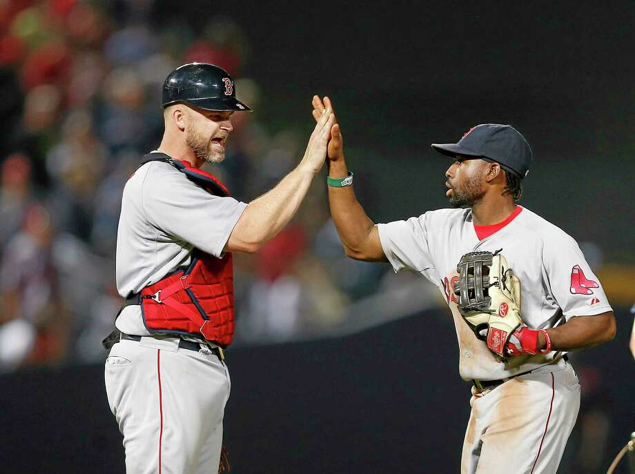 Red Sox center fielder Jackie Bradley Jr., right, and catcher David Ross celebrate after the Red Sox defeated the Atlanta Braves 6-3. Photo: John Bazemore — The Associated Press   / AP