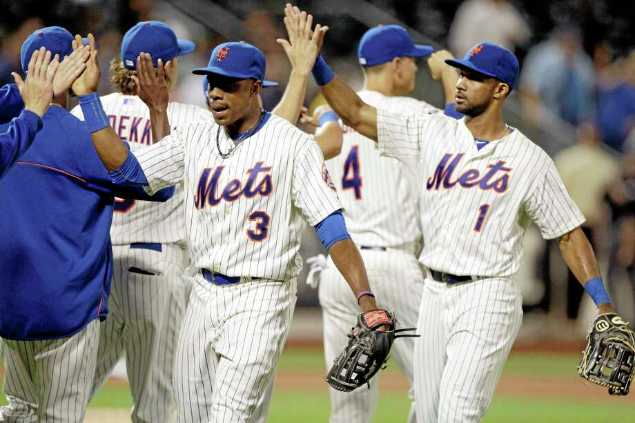 The Mets' Curtis Granderson (3) and Chris Young (1) celebrate with teammates after a 4-2 win over the Pittsburgh Pirates. Photo: Frank Franklin II — The Associated Press   / AP