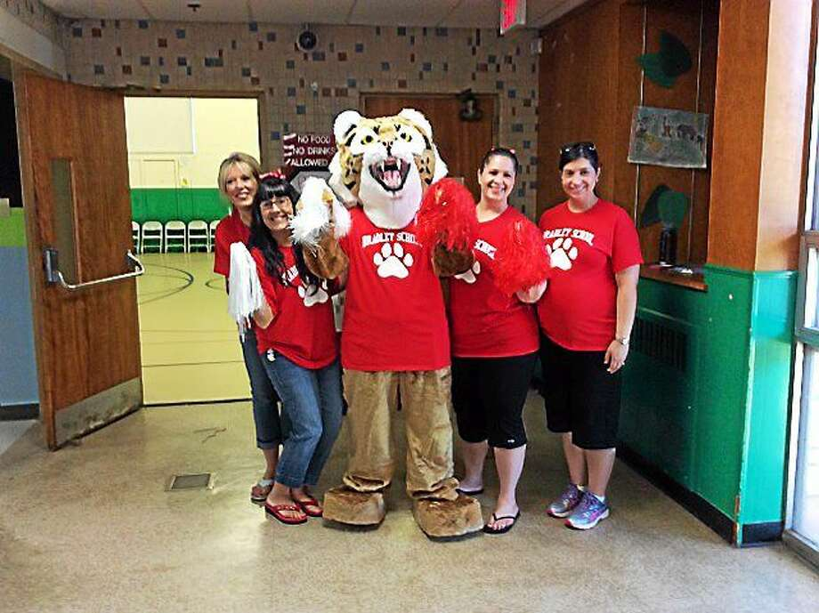 Bradley School staff. left to right: Catherine Pomeroy, Nichole Green, Amy Tancreti, Lisa Detoro and Allison Hill in the Bobcat costume. Contributed photo. Photo: Journal Register Co.