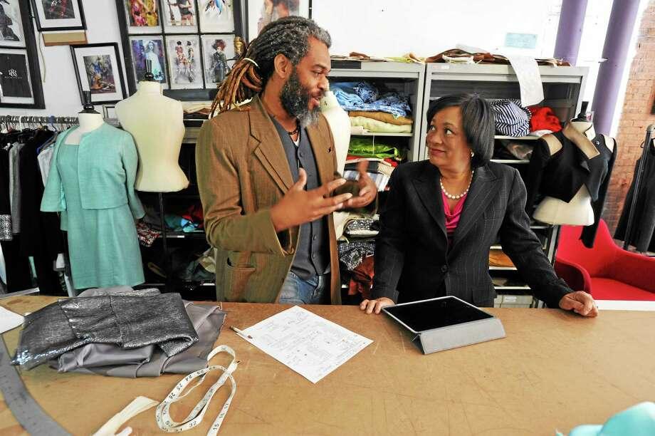 New Haven Mayor Toni Harp visits Neville Wisdom's Fashion Design Studio Thursday, where Neville showed her the design and fabric for her dress for the inaugural. Photo: Mara Lavitt — New Haven Register       / Mara Lavitt