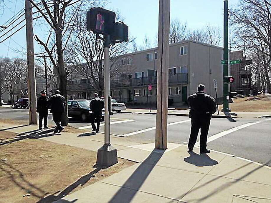 Police comb the area where gunfire was reported. Photo: Mercy Quaye — New Haven Register